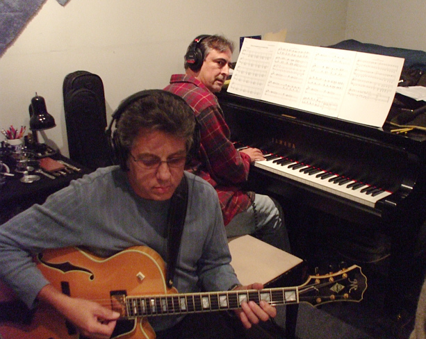 "Frank Potenza on guitar and Jeff Colella at the piano, going over a chart during Susan Kohler's ""Just Harold"" sessions at Theta Sound Studio"