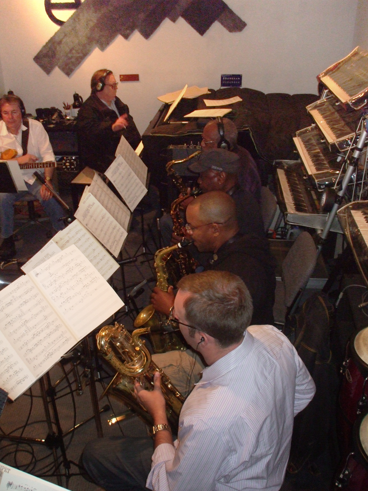 """Adam Schroeder on Baritone Sax, Rastine Calhoun on Alto Sax, Fred Jackson on Alto Sax and Charles Owens on Tenor Sax comprise the woodwinds section for Mel Carter's """"The Other Standards"""" big band recording sessions at Theta Sound Studio. Also pictured: guitarist Grant Geissman and arranger/pianist John Rodby."""