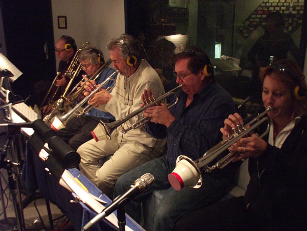 "Another view of the brass section with producer Susan Kohler listening from the control room during the ""Just Harold"" sessions"
