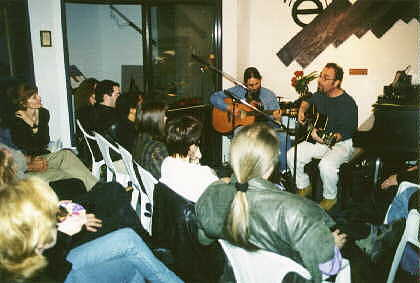 Kevin Fisher (right) and David James, collectively known as Naked to the World, opened the premiere edition of the Theta Sound Coffee House with a set of dynamic material from their CD releases.