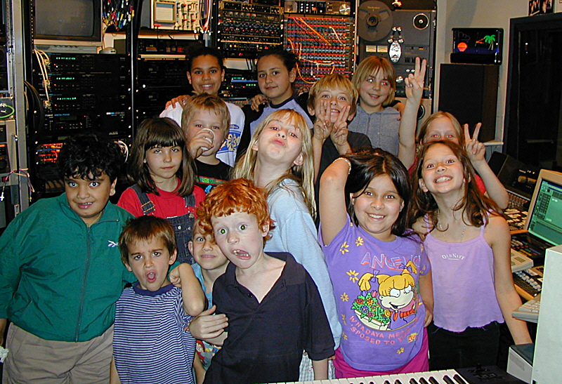 It's pretty obvious, these guys and gals are having too much fun after their class field trip at Theta Sound Studio. One of the things we do with young people is we get them to learn how to actively LISTEN. This then becomes a skill that can be cultivated toward greater awareness of sound and space. Another thing we do is have each of them speak on the mic while we alter the pitch of their voice in real time. The kids in the control room go bananas when they hear their classmate in the studio sounding like a chipmunk or Godzilla!