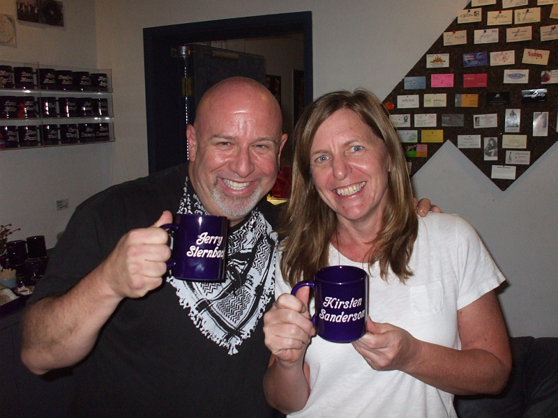 "Jerry Sternbach and Kirsten Sanderson with their ""Mug Club"" hardware during a recording session for the new musical, ""Clowntown."""