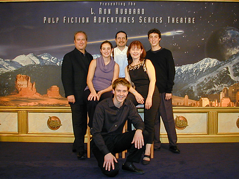 """With the cast of """"Trouble on His Wings"""" on the stage at L. Ron Hubbard's Pulp Fiction Adventure Theater on Hollywood Boulevard. Randall Michael Tobin composed the score for this reading and introduced the musical overture paradigm to the live shows."""