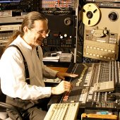 "At the console and having a really good time in Theta Sound Studio's control room, Randall Michael Tobin is ""in the zone…"""