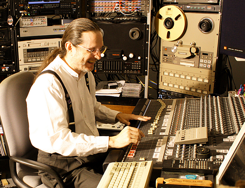 """At the console and having a really good time in Theta Sound Studio's control room, Randall Michael Tobin is """"in the zone…"""""""