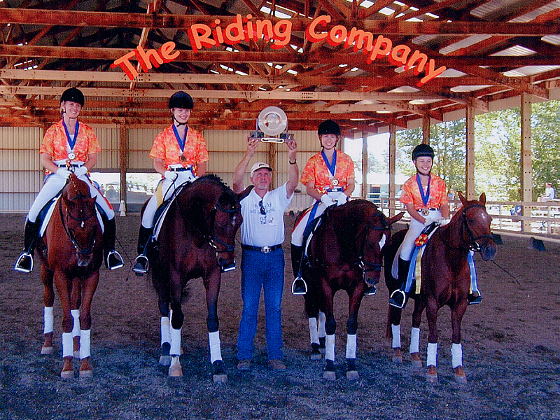 """Michele Purpora-Tardi of Robele Farms Riding Academy commissioned Randall Michael Tobin to write music for her Equestrian Quadrille team (four horses and riders performing dressage-style gates and maneuvers to music). She explained the costume theme for that year and provided a videotape of the routine. The music was scored using that tape as a guide for tempo changes, and the finished piece was named Caribbean Carnivál. After their performance in Paso Robles, California, The Riding Company at Robele Farms won the National Championship in their class! You can see a video of that routine performed at the Los Angeles Equestrian Center <a href=""""https://www.thetasound.com/?gallery=video-production#quadrille"""" target=""""_blank"""">here</a>."""