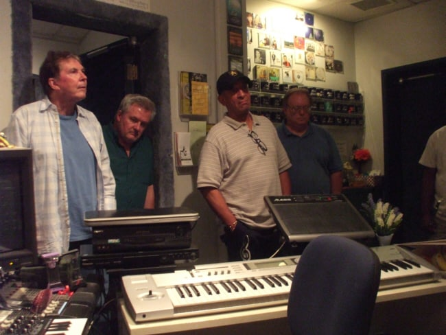 "Grant Geissman, Steve Pemberton, Mel Carter and John Rodby listening to the playback of ""Something to Remember You By"" during the ""Mel Carter Continues..."" sessions at Theta Sound Studio"