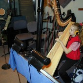 Emily was nine-years old when she agreed to be the harpist in the Snow Queen Ballet orchestra for the December 2000 performances at the Glendale College Performing Arts Auditorium. Here she is at Theta Sound rehearsing her parts for the show.