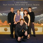 "With the cast of ""Trouble on His Wings"" on the stage at L. Ron Hubbard's Pulp Fiction Adventure Theater on Hollywood Boulevard. Randall Michael Tobin composed the score for this reading and introduced the musical overture paradigm to the live shows."